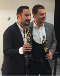 جواد عزتی در کنار نوید محمدزاده